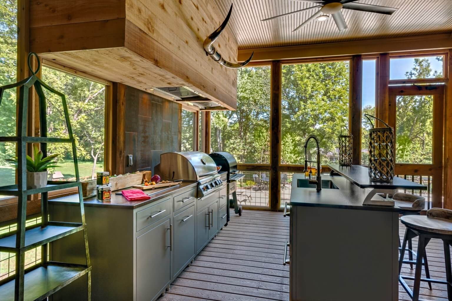Cappuccino powder coated aluminum kitchen cabinet under a screened patio