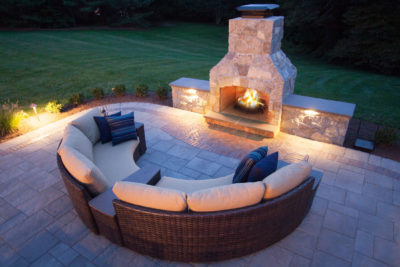 masonry outdoor fireplace in backyard